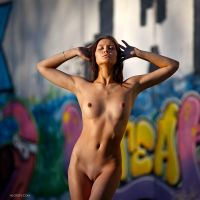 Nude on graffiti by Aloisov