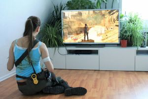 Lara Croft playing the Tomb Raider game by DayanaCroft
