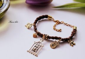 Bracelet with a bird in a cage by KaoriArt