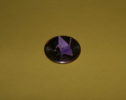 Small origami crane on dime by MuggleHater