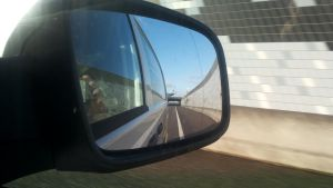 Objects in the rear view mirror... by Brandzai