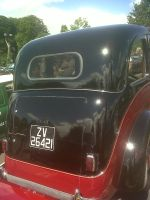 rear of old style taxi by DazKrieger