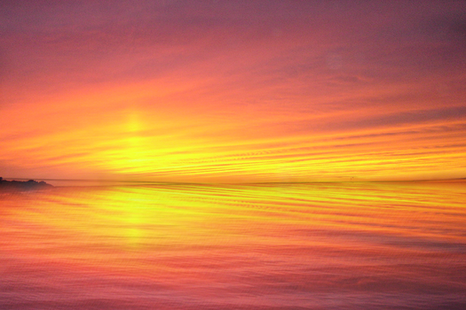 Sunset on reflective sea by Kirsten99