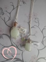 Faerie Lantern necklaces by ilikeshiniesfakery