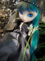 Talking to the snowdrops. by masked-elf