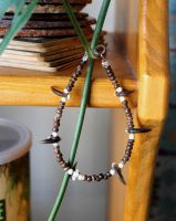 Raccoon claw bracelet by lupagreenwolf