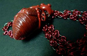 Human Heart Necklace 4 by Divulged