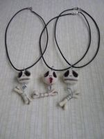 Skully and bone necklaces by SoDarkSoCute