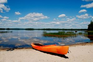 Kayak and Sky by GeraldWinslow