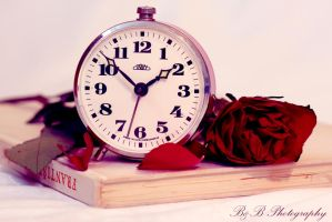 Alarm clock with rose by PoisonAgency