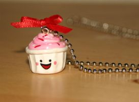 Pink happy face cupcake necklace by jbphillips