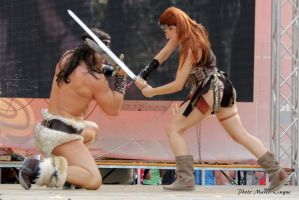 Red Sonja and Conan Fight by Evejo
