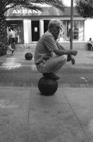 A man sitting on a ball by TanBekdemir