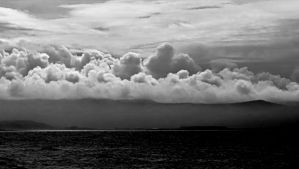 Clouds and a small sun spot by UdoChristmann
