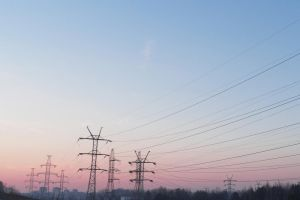 Power lines at sunrise by Ri-Misato