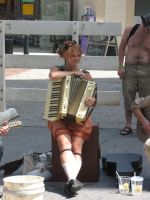 The Accordian Player by LadyLewind