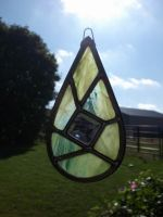 Leaded teardrop suncatcher,swamp thing green.. by glasslinger