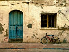 The blue door and the bike by shuckaby