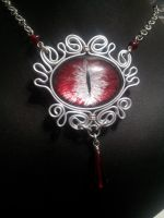 Blood eye in silver flat wire by BacktoEarthCreations