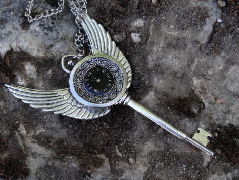 Steampunk winged watch necklace by Hiddendemon-666