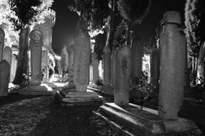 Old ottoman cemetery in a windy night by TanBekdemir