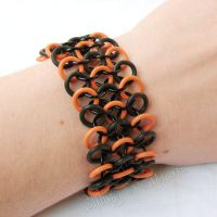 Black and Orange Bracelet by merigreenleaf