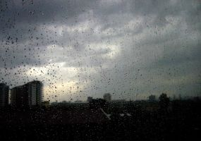 it's raining over the city. by Anitya