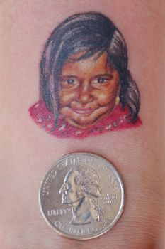 miniature portrait of a girl by Mariotattoos