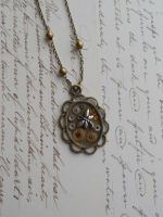 Stempunk pendant with small gears and dragonfly by SteamJo