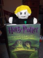 Malfoy Escapes the Books by Checker-Bee