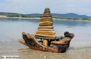 Land art-driftwood and stones sailboat in Hungary by tom-tom1969