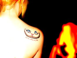 cheshire cat tattoo by Galapagos23