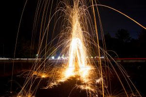 Parting Of Sparks by KingPinPhotography