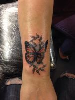 Butterfly tattoo by Cloud9images