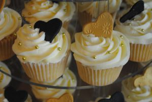 Black and gold cupcakes by starry-design-studio
