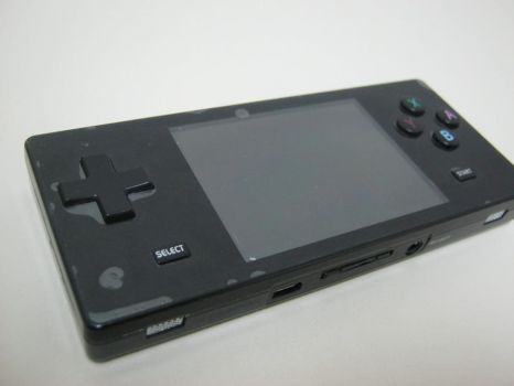 Dingoo A320 portable videogame by oilusionista-stock