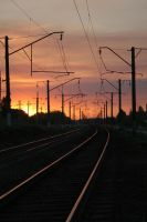 Sunset on a railroad stock #1 by croicroga