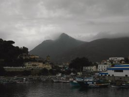 Harbour and Mt Sidi Achour in the mist by yuushi01