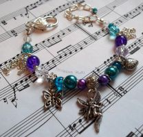 Blue and purple adjustable bracelet with charms by TerraNovaJewels
