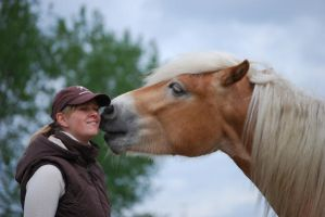 Love between a girl and horse. by PhotoVie