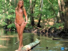 Girl on a tree in a river by soerennb