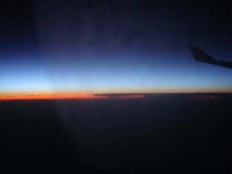 Sunset from an Aeroplane by scuzziness