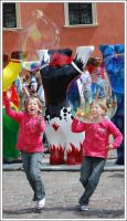 Kids playing with soap bubbles by bwanot