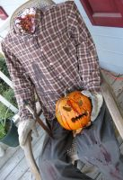 Halloween 2007 - Front Porch Pumpkin Head by technodrumguy
