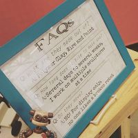 Updated FAQs signage on my worktable at Artegon by HerArtSheLoves
