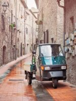 Small vehicle in an old city. by 8moments