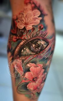 Surreal eye and flowers tattoo by eminimal