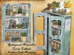 Mini Steampunk Curio Cabinet by grimdeva