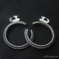 Silver temple rings from medieval Poland by Sulislaw
