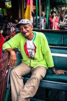 smiling pedicab driver by fantanicity